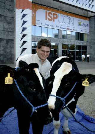 Winner, Donny Simonton, poses with Tucows' two cows at ISPCon in San Diego.